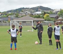 Ole Football Academy Technical Director Ben Sippola coaches a group of youngsters at the Wanaka...