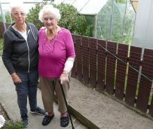 Balclutha neighbours Ila Ryan (left), and Val McNamara stand next to a garden border where Mrs...