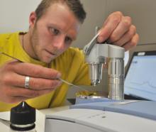 Know Your Stuff NZ Dunedin team leader Ashley Heydon legally tests a drug sample at the...