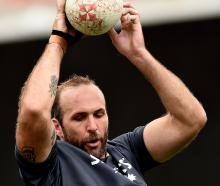 Highlanders lock Bryn Evans gets in some lineout practice at a training run at Forsyth Barr...