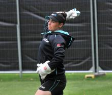 Katey Martin throws a ball as the White Ferns train at the University Oval yesterday morning...