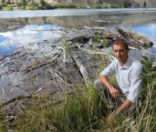 Lake Dunstan Charitable Trust projects manager Duncan Faulkner shows some of the detritus built...