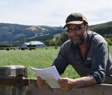 Sheep and beef farmer Fred Doherty reads a letter from Otago Regional Council declining his...