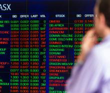 A man looks at the electronic display of stocks at the Australian Stock Exchange. Photo: Getty...