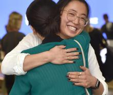 Sydney University student Isabella Lau (21) smiles as she embraces her mother, Dunedin...