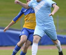 South City Royals' Ollie Cassidy seeks to shrug off the challenge of University's Ben Stanley at...