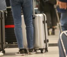 Passengers on Air New Zealand flights were today asked to submit to themselves being weighed as...