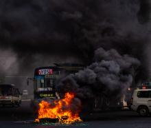 Smoke rises from tyres set alight by anti-coup protesters in Yangon earlier this month. Hundreds...