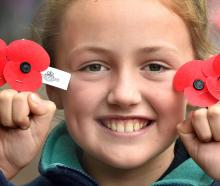 Smiling with her poppies outside the Golden Centre is Grace Slocombe (10) of Dunedin. PHOTO:...