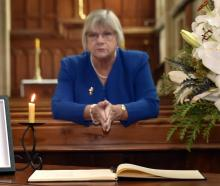 President of the Victoria League in Otago Christine Bell with a condolence book at St Paul's...