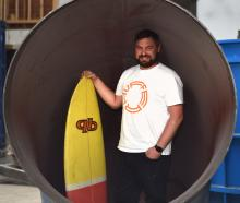 Dunedin entrepreneur and inventor Ross McCarthy stands inside one of the huge pipes that make up...