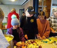 Chopping fruit for relish at the Wanaka Autumn Apple Drive at Rippon Hall on Saturday are (from...
