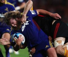 Highlanders hooker Liam Coltman looks to break a tackle against the Chiefs in Hamilton in 2013....