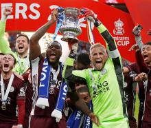 Leicester City's Wes Morgan and Kasper Schmeichel celebrate winning the FA Cup. Photo: Reuters
