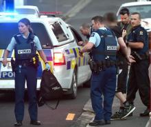Dunedin police take a man into custody following an alleged theft in North Dunedin yesterday....