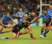 Chase Tiatia of the Chiefs is tackled by Western Force players. Photo: Getty Images