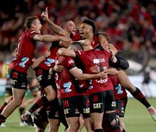 The Crusaders celebrate after winning a tense final against the Chiefs in Christchurch. Photo:...