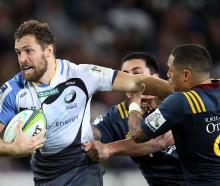 Luke Morahan tries to break the tackle of Aaron Smith when the Force played the Highlanders in...