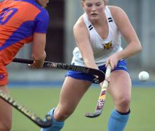 University Huskies Adyn Dudley (right) looks to control the ball ahead of City Highlanders player...