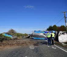 A milk tanker on its side after it crashed near Dacre, Southland. Photo: Laura Smith