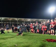Crusaders head coach Scott Robertson breakdances after another finals win from his team. Photo:...
