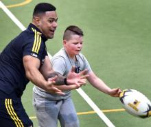 Injured Highlanders centre Fetuli Paea plays a game of touch with Noah Stevenson (9) at the...
