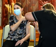 Prime Minister Jacinda Ardern receives her first Covid-19 Pfizer vaccination yesterday in...