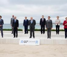 Posing for a group photo at the G7 summit are (L-R) Canadian Prime Minister Justin Trudeau,...