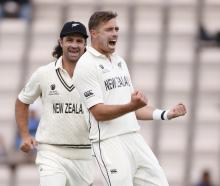 Tim Southee celebrates taking the wicket of India's Rohit Sharma. Photo: Action Images via Reuters
