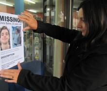Chris Bates' sister-in-law Sidonee Bates puts up a flyer on February 21, 2018. PHOTO: ODT FILES