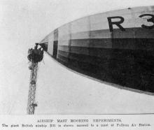 The giant British airship R33 is shown moored to a mast at Fulham Air Station. — Otago Witness,...