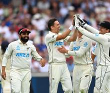 Black Caps Trent Boult and Tom Blundell celebrate a wicket during last night's first day of the...