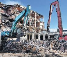 Ceres demolition plant matches the scale of the task as company staff survey the centre of the...