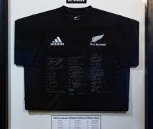A signed, framed All Blacks jersey on Trade Me. Photo: Supplied