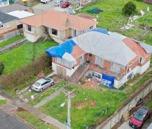 An aerial shot shows some of the damage to homes in Papatoetoe caused by the tornado that tore...