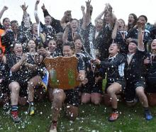 Pirates celebrates a dramatic 29-26 win against University in the final at Hancock Park on...