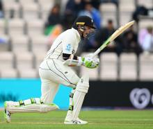 Black Cap Tom Latham hits runs during Day 3 of the ICC World Test Championship Final between...