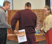 The winner of both ''New Chapters'' categories receives his prizes from judge Becky Manawatu...