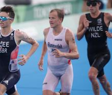 New Zealand's Hayden Wilde (R) in action during the race. Photo: Reuters