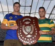 Taieri captain Ben Morris (left) and Green Island co-captain Sam Eriepa hold the Dunedin premier...