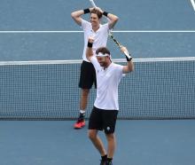Marcus Daniell and Michael Venus celebrate winning the bronze medal match against Tennys Sandgren...
