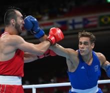 David Nyika (R) fought Muslim Gadzhimagomedov in the semifinal of the men's heavyweight boxing...