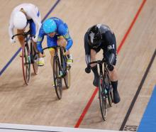 Ellesse Andrews crosses the finishing line first during heat 1 of the women's Keirin repechages....