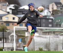 Otago outside back Matt Faddes boots the ball ahead during a training session at Logan Park...