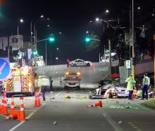 The BMW crashed in Auckland's Mt Roskill at about 1.30am. Photo / Hayden Woodward