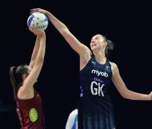 New Zealand's Kelly Jury blocks England's George Fisher during game one at Christchurch Arena...