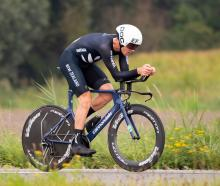 New Zealand rider Tom Scully competes in the elite men's time trial at the world road cycling...