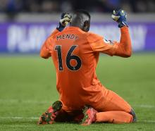 Chelsea goalkeeper Edouard Mendy celebrates after the match. Photo: Reuters
