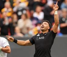 Richie Mo'unga celebrates his try against the USA Eagles during the match in Landover, Maryland...