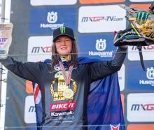 Courtney Duncan holds up her winner's gold plate at the MXGP of Trentino in Italy yesterday....